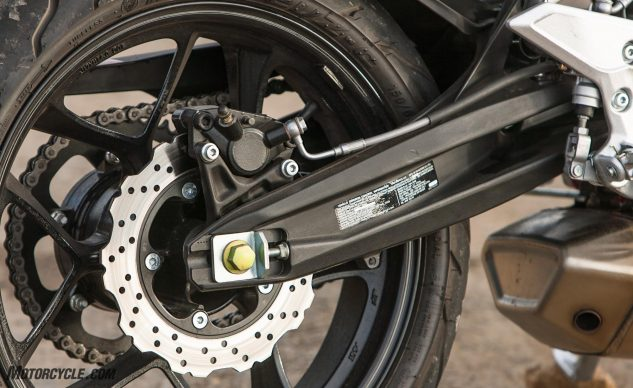 Aluminum swingarm, racy chain adjuster hardware and steel brake lines are all upscale for the baby Hyosung.