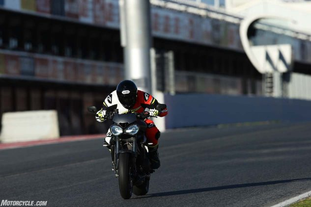 The 2017 Street Triple RS topped out at 149 mph down Catalunya's front straight. Never once did the fairingless naked wobble or give any hint of instability at the track. Pirelli Diablo Supercorsa SP tires (stock on the RS) certainly helped. Footpegs were occasionally grinding away, but not enough to hinder the bike as a damn fun trackday toy.