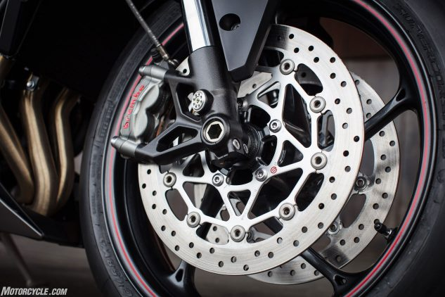 Outfitted with Brembo M50s, braking performance goes unquestioned. The fully adjustable Showa fork and Öhlins STX40 monoshock felt great on both the street and track. Street speeds were a little slow-going due to wet, foggy weather, but track speeds were full tilt, and both ends of the Triumph handled everything Catalunya threw at it. Note the 90-degree air valve.