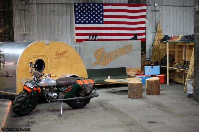 Danner Boots brought their shop feel into the vendor area with stumps and a wee trailer. Because Portland!