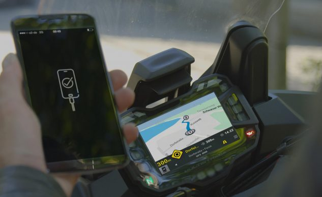 The mySPIN experience connects the computing and communication power of the smartphone to the motorcycle.