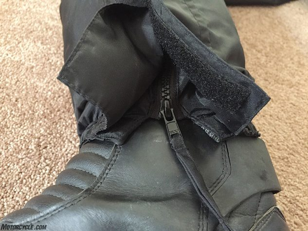 Wind is not getting up the bottom of your pant legs because the Thermosuit fastens tightly enough around boots to stop any wind incursion. The same can be said of the cuffs and the collar. All zippers (there's only three) are covered by storm flaps to keep the rain out.