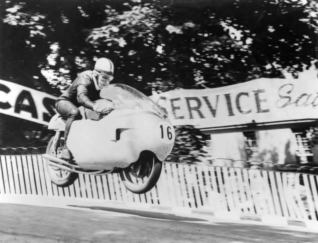 John Surtees was the first rider to win the Senior TT at the Isle of Man three years in a row.