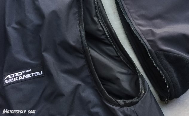 The optional removable sleeves zip to the vest's arm holes. The overlap between the vest and the sleeves are designed to keep drafts at bay.