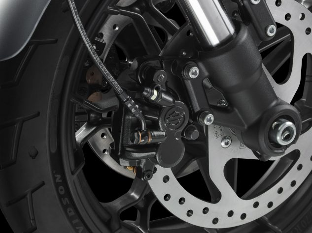 Meh… twice as many brakes don't result in twice as much braking power. Those two-piston slide-type calipers seem designed not to scare beginners with too much power. ABS will set you back an extra $750.