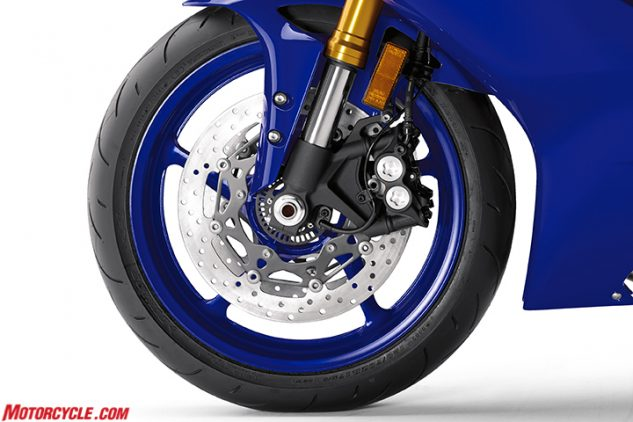Brake discs are bigger now, and the wheel-speed sensor in the center is used for both ABS and traction-control functions. Both Bridgestone and Dunlop are supplying tires for the R6.
