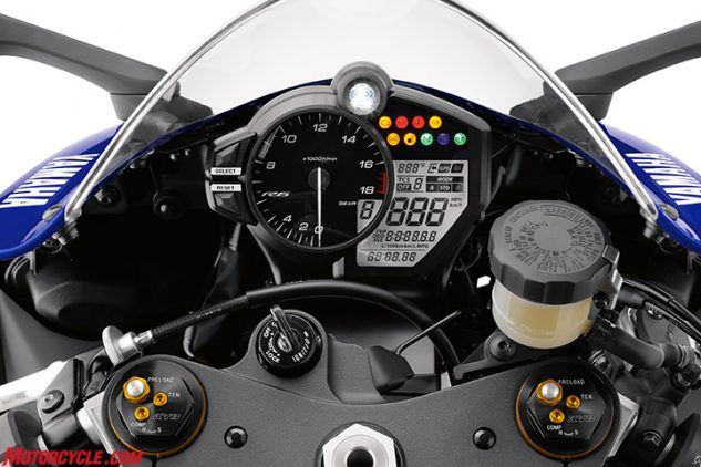 Much of the new R6's major updates are captured here. From the updated instrument display you can see the bar labeling the traction-control settings and ride-mode position. At the bottom of the picture is the new KYB fork, borrowed from the R1 and adapted for use in the R6. And off to the right is the new Nissin master cylinder, replacing the Brembo unit of yesteryear.