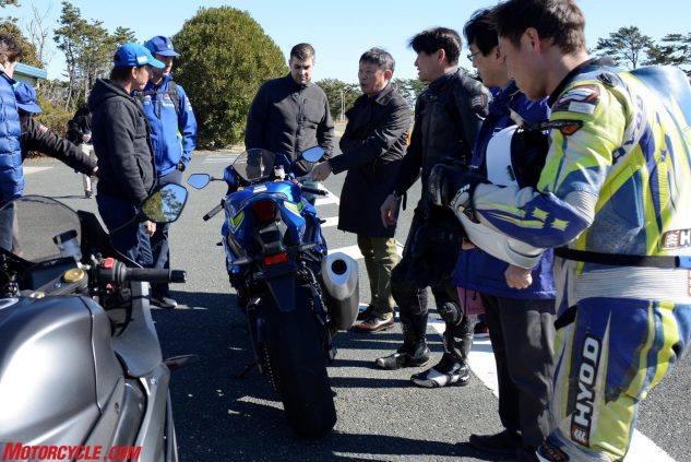 Takeshi Hayasaki, president of Suzuki Motor of America, points out some details of the 2017 GSX-R1000. Next to him in the black leathers is Yuichi Nakashima who has logged 30 years at Suzuki. We're happy to report that Nakashima hasn't lost his enthusiasm for the job, as evidenced by the lovely stand-up wheelie he performed while riding past the pit box in front of a group of difficult-to-impress journalists.