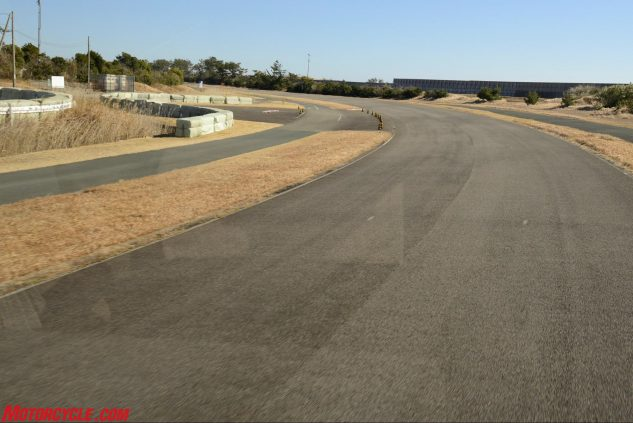 This is the final corner of the Ryuyo test track leading onto the front straight. To the left of this shot out of frame is the motocross track. Straight ahead past the fence is the Pacific Ocean.