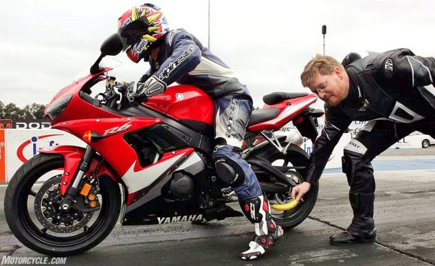 I'm at the dragstrip trying to cut a good E.T. during a MotoUSA supersport shootout. MO's Publisher and Editor in Chief back then, Sean Alexander, tries to subvert my efforts.