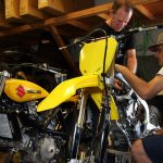 Doug Chandler working on Suzuki dirtbike