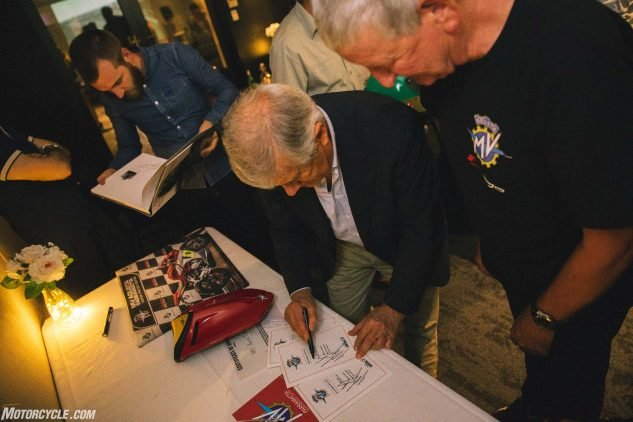 Taking time to sign plenty of autographs for the lucky few of us present. There were only 27 of us invited to the dinner.
