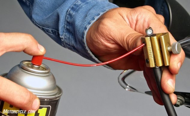 How to Lube Throttle and Clutch Cables - spraying silicone-based lubricant