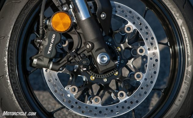 Tokico calipers don't jump out as wheel jewelry like our beloved Brembo M50s, but the radial-mount two-piece clampers and 320mm discs performed better than we expected. Great stopping power as well as feedback at the lever.