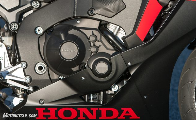 That's not actually the engine you're looking at, it's plastic covers for the engine. According to Honda it's not for aesthetic purposes, it's to help meet stringent noise limits. Honda, always playing by the rules.
