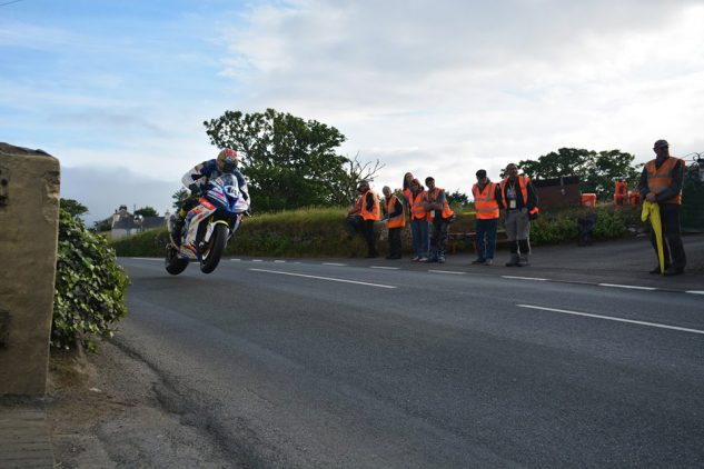 Marshals on the job as bikes fly by. Photo by Andrew Bell