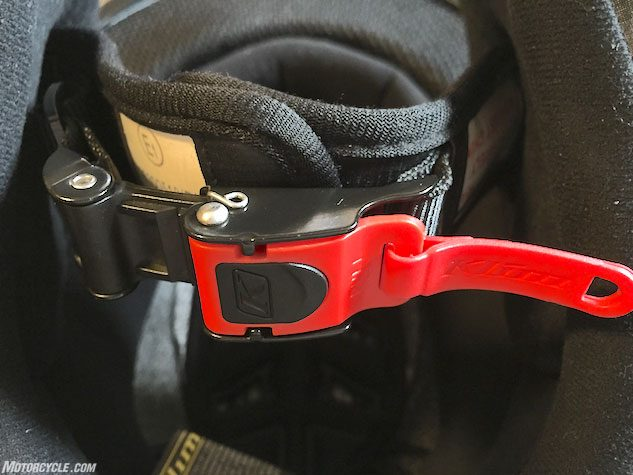Occasionally more contentious than the current state of U.S. politics is the use of a buckle to secure a motorcycle helmet instead of D-rings. After appropriately adjusting the buckle it's simple to latch and utilizes a dual-hinge system to unlatch, keeping the buckle secure during a crash, while also making the release function a one-handed affair.