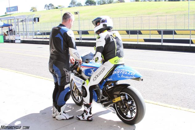 An excited yet nervous Jeff Ware chats to the owner prior to testing the bike at Eastern Creek Raceway.