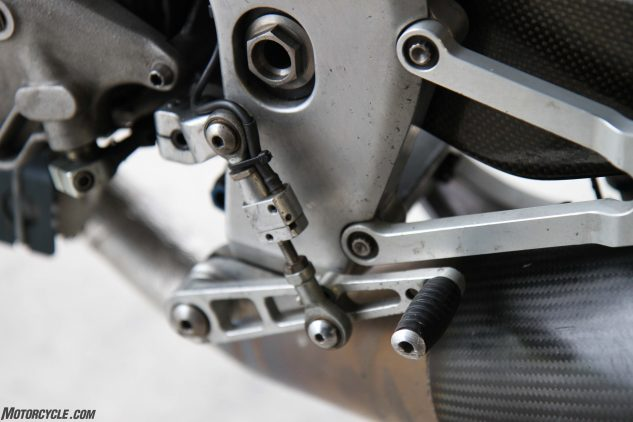Programmable quickshifter is super slick and tiny as are the super thin rearsets made of high-grade aluminum.