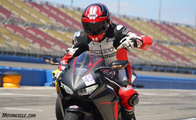 """Leaving the track after his first ride aboard the Honda, Evans excitedly points and exclaims, """"I can't believe it's not butter!"""""""