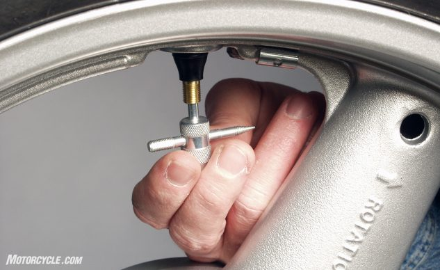 Remove the valve core from the valve stem and let the tire deflate.