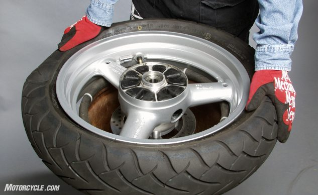 Working your way around the tire, press the bead into the center depression in the wheel. Flip the wheel and repeat.
