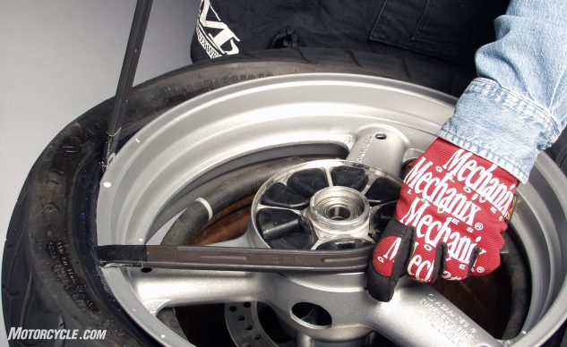 Work deliberately with the tire irons. Your discs, knuckles, and rim paint will be much happier.