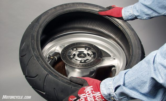 When mounting the new tire, you should be able to press most of the bead over the lip by hand. On the second bead, keeping the first one in the rim's center depression will help.
