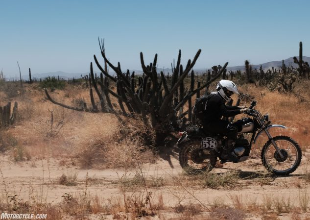 The 58 bike back on the trail after a repairing a gas tank leak at a pit stop in El Crucerito.
