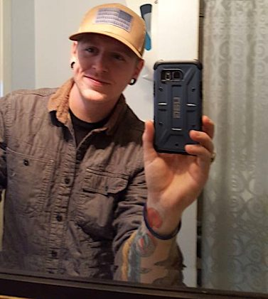 Cellphone, bathroom mirror evidence that MO's newest editor is of the selfie generation.