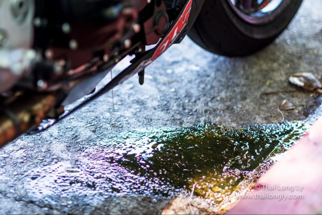 Oil is equally effective at lubricating the ground as it is your engine.