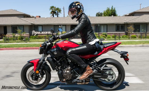Vogue Manor indeed: Six-foot Tamara likes the FZ's ergos but isn't a big fan of the thin (but wide) seat. Note the full-size 180/55 rear tire and powerful four-piston brake calipers up front. The FZ is not a toy.