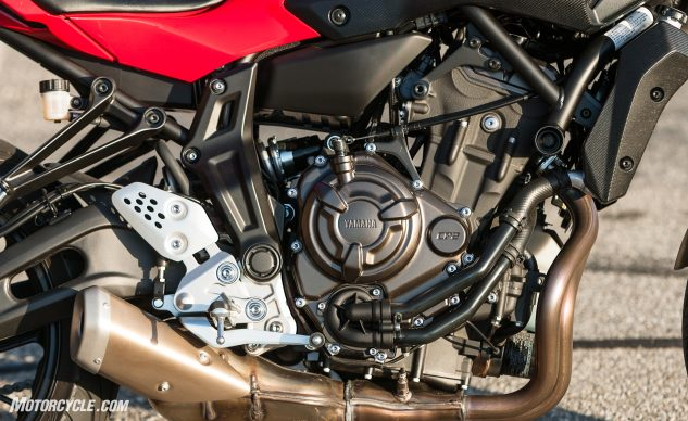 Kawasaki lifted the Z650's frame directly from the FZ, which lifted the concept of flexy front engine mount ears directly from the M1 MotoGP machine. Both the FZ and Z650 turn right now.