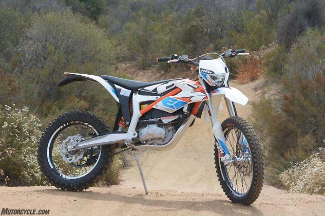 KTM's Freeride-E boasts some impressive componentry. A chro-moly steel section in orange mates to a cast-aluminum configuration below the seat to comprise the frame, while the subframe is a high-tech plastic structure that helps shave weight. Wheels feature aluminum rims and spoke nipples and CNC-machined hubs. Aluminum swingarm with a machined section shows attention to detail. Without its battery, the bike would weigh less than 190 pounds.