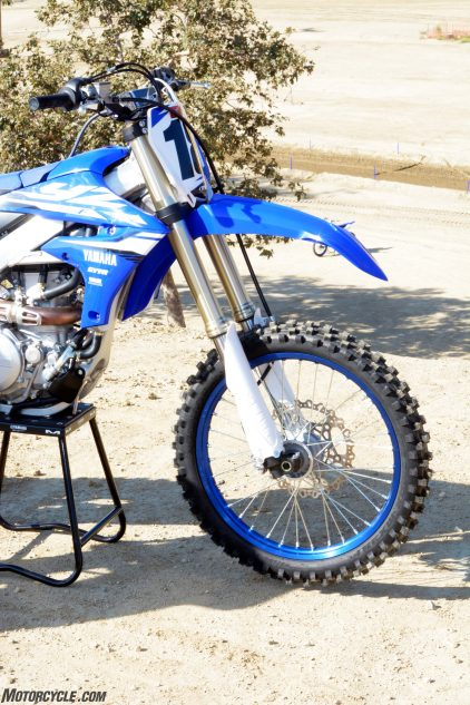 The YZ450F's 48mm KYB SSS fork underwent some revisions for 2018. including a new mid-speed valve spring design and updated valving specs.