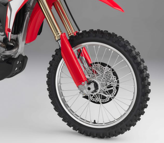 The CRF250R now features a 49mm Showa coil spring fork instead of an air fork. The internals are a production version of Showa's A Kit race suspension.