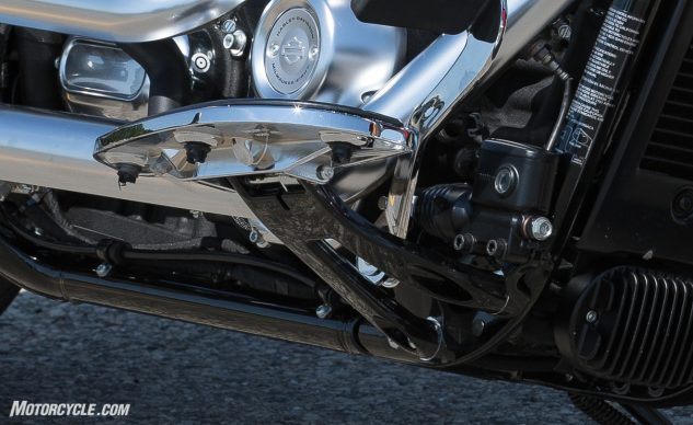 The forged aluminum floorboard brackets assist in both the improved lean angle and the weight loss.