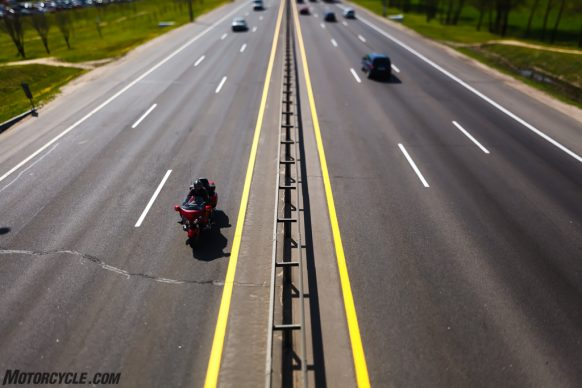 Blur motion motorcycle rides on the highway top view