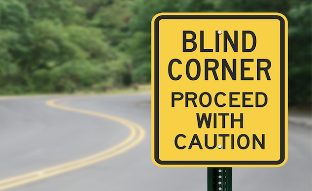 052419-top-10-track-day-reasons-07-blind-corner-caution-sign