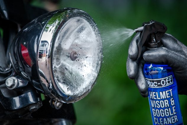 Spraying a headlamp with Muc-Off Helmet & Visor cleaner makes quick work of the bugfest build up.