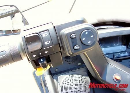 Here you can see the speaker covers and the FM / MP3 player controls. The orange button in the center of the handle bars is the hazard lights button.