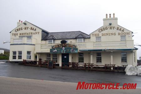The famous Creg Ny Baa pub along the TT course is a popular location from which to watch the race. And you can get some good, hardy Manx food there as well. Oh! And a pint, too!