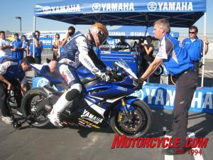 Yamaha's race team demonstrates the proper way to do a pit stop for roadracing star Ben Bostrom.