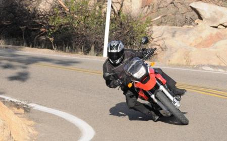 The littlest GS holds its own in the twisties thanks to a stable chassis, however, keeping the tach spinning around 6K rpm and above is necessary to keep faster riders or bigger bikes in sight.