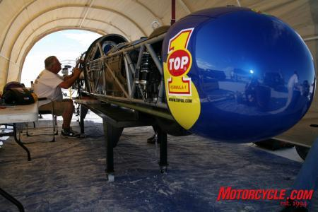 Mike Akatiff at work on the machine he created. This was taken in the Top 1 Ack Attack pits at Bonneville during a speed trial. (Photo courtesy Nathan Allred)