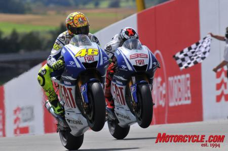 Valentino Rossi out-raced Fiat Yamaha teammate Jorge Lorenzo by a mere 0.099 seconds.
