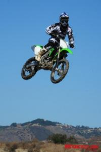 The KX's new suspension had no trouble handling big air off of Pala's double jumps.