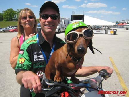 The paddock scene is often a great place to be, especially with characters (and Hall-of-Famers) like Jay Springsteen around. Here Springer is sandwiched by wife Judy and pooch Diesel.