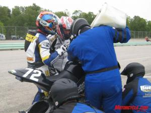 Troy debriefs me after his long session while the crew replenishes fuel and fits a set of rain tires for my session.