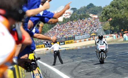 With Jorge Loernzo's win at Estoril, the pressure is now on Valentino Rossi to hold off his teammate and rival.